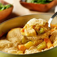 Slow-Cooker Chicken & Dumplings: The slow-cooker simmers chicken, potatoes, carrots, and celery in a creamy sauce and is topped with tender dumplings made easy and delicious with baking mix. | rachaelraymag.com
