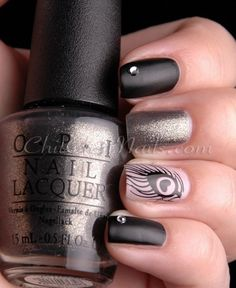 Creative-Nail-Art-Designs-for-Valentines-Day-2014__16.jpg 570×696 pixels.  I like the black and silver nails not the feather one.