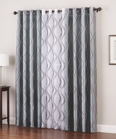 i love the idea of layering solid with pattern on the drapes hang