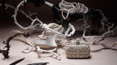 Alexander McQueen - amazing cream clutch with silver skull accent; asymmetrical white platform heels (I just LOVE these together!)
