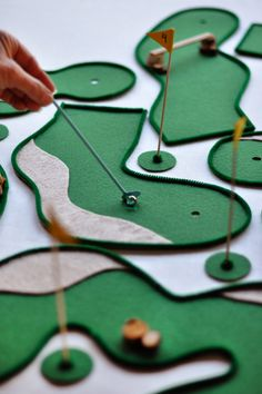 Golf Gifts Make the most of your snow days this winter by making this clever DIY table top mini golf game from Oh Happy Day! - Make the most of your snow days this winter by making this clever DIY table top mini golf game from Oh Happy Day! Mini Golf Games, Play Golf, Golf Games For Kids, Mini Golf Set, Golf Ball Crafts, Diy Table Top, Suncatcher, Miniature Golf, Crafts For Kids