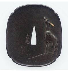 """Natsuo School - Tsuba with Design of Deer and Moon. Iron, Gold and Silver with Takabori & Zogan. Mid to Late 19th Century.  3-1/8"""" x 2-3/4"""" (8cm x 7cm)."""
