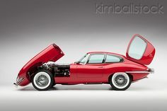AUT 30 RK5112 01 - 1966 Jaguar XKE Coupe Red Engine Detail Profile View Studio - Kimballstock