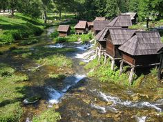 Discover Watermills of Jajce in Jezero, Bosnia and Herzegovina: This cluster of little wooden huts once ground local farmers' wheat into flour during the days of the Austro-Hungarian Empire. South Beach, Countries Europe, Austro Hungarian, Bosnia And Herzegovina, Macedonia, Albania, Slovenia, Windmill, Garden Bridge