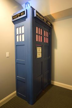 OMG - A Tardis entrance to a home theater / media room. Totally going to do this to my future house. Except it would be full-size on the outside, not just some of it sticking out from the wall.