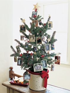 Make color copy ornaments of your favorite pictures. Cut red, gold and green paper into mini mats with slits in the corners to hold the photos in place. Finish the ornaments with ribbon hangers