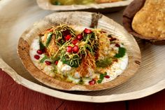 Dahi Bhalla Chaat Delhi style recipe. Burst of diverse flavors in your mouth. Soft vadas soaked in chilled sweetened yogurt, topped with green chutney, sweet tamarind chutney, sprinkled with roasted cumin powder, sev and coriander leaves.