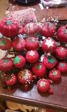 nice collection of tomato pin cushions with strawberry