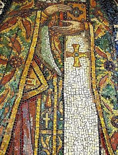 5.21.15 Mosaic and shapes- this mosaic from the Byzantine Period has unique colors from that period and beautiful shapes that make up a person holding a what it looks like a bible.