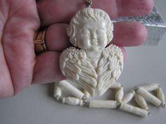 Cheeky Little Cherub         Hand Carved Ox Bone by CRAFTERBYHEART, $49.00