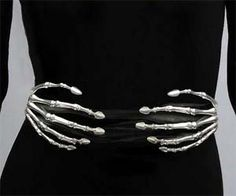 Give yourself a uniquely sinister look with the skeleton hands belt. These hand made skeleton hands belts are crafted from sterling silver and placed on a black leather belt, giving it a bold look that will look great on a little black dress. Buy It $4,000.00 via CoutureLab.com