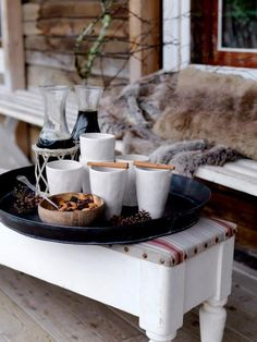 Bring your hot chocolate bar outside for an extra cozy treat (with lots of knit blankets!).