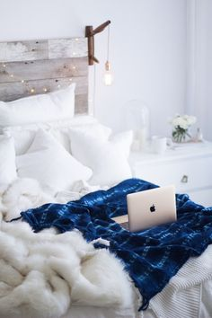 All white bedroom & boho indigo blanket