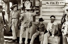 """October 1939. Neches, Texas. """"Mexican migrants drinking cold drinks and buying candy at filling station where the truck taking them to their homes in the Rio Grande Valley has stopped. They had been picking cotton in Mississippi."""" Photograph by Russell Lee for the Farm Security Administration."""