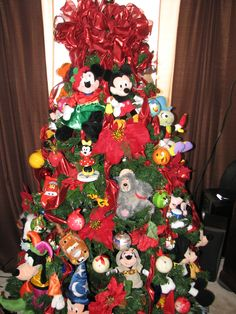 disney christmas tree put together with stuffed disney toys found at a thrift store - Christmas Tree Toy Decorations