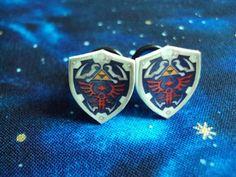 hylian shield -  legend of zelda ear plugs by Alienphant. Amazing !