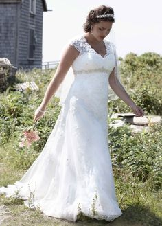 LOVE This!!! would want it more off white/beige. Plus size lace wedding dress