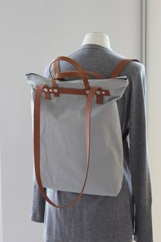 Hellgrauer Rucksack aus Canvas, auch als Tasche tragbar / light grey backpack with leather straps made by DaBelJu via DaWanda.com
