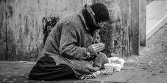Image credit: Man praying on sidewalk with food, Sergio Omassi.