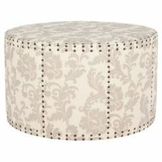 "Round ottoman with nailhead detailing and acanthus leaf-print upholstery.  Product: OttomanConstruction Material: Plywood and fabric upholsteryColor: Taupe and beigeFeatures: Nailhead detailingDimensions: 20.1"" H x 33.9"" Diameter"