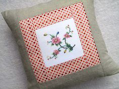 LOVE this idea...maybe for some of the old pillowcases we have stashed away?  OR, to frame?