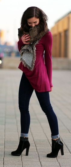 How to wear a long tunic with skinny jeans and a plaid blanket scarf. Fashion blogger Marie's Bazaar pairs Dynamite Clothing super flattering dark wash high waisted jeans with black leather and suede bow booties, a berry long sleeve tunic, and a brown plaid blanket scarf for Fall