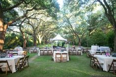 Sweetgrass Social wedding at Legare Waring House. Stacy & Patrick. Reception space under oak trees.