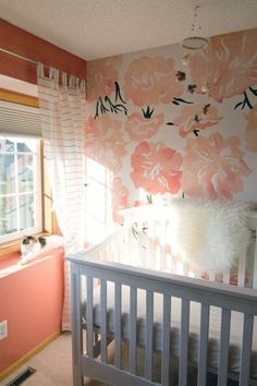We're loving this hand-painted peony accent wall - this would be gorgeous with our coral camilla ruffle baby bedding.
