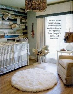 What a neat rustic baby room... I would love that painted wall in my living room or reclaimed wood to add. I love the nursery bedding too and light. @Danielle Lampert Lampert Lampert McGuffee