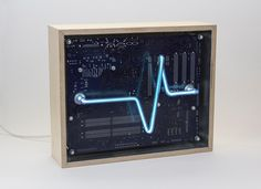 We create [dys]functional spectr-objects using recycled electronics and light. Machine Age, Silver Paint, Wooden Frames, Recycling, Objects, Waves, Neon Signs, Create, Box