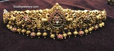 Beautiful gold vadanam with swan design and lotus flower motif at cneter. Vadanam studded with pink white and green color precious stones. Waist belt with gold pumpkin hangings. Kids Gold Jewellery, Gold Jewellery Design, Gold Jewelry, Gold Bangles, Quartz Jewelry, Temple Jewellery, Jewelery, Antique Jewellery Designs, Antique Jewelry