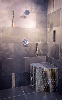 A modernized shower with metallic glass accents. #thetileshop