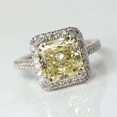 Fancy yellow cushion cut diamond ring from Oliver Smith Jeweler.