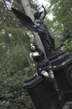 Goth girl by monument at cemetary