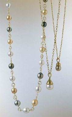 Drop Pearl Necklace: Love it! I want both the light and dark-pearl drop necklaces and I would wear them together!