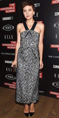 MAGGIE GYLLENHAAL Maggie's black-and-white Roland Mouret halter, worn to a screening for The Honourable Woman in N.Y.C., is anything but basic thanks to the graphic print, thick black straps and back slit.