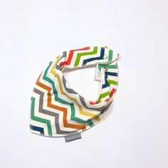 This is by far the BEST drool kerchief / bib / Special Needs saliva absorber we have thus far found. Our average-sized 8 year-old wears these comfortably. Soft and well-made.  Big kid bandana bib kerchief  Birch Fabrics by SweedieKids, $14.00
