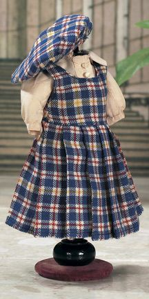 Le Clan  from the Summer 1954 catalog,a three-part ensemble comprising peach silk-like blouse,Scottish blue plaid jumper with pleated skirt,and Scottish tam.