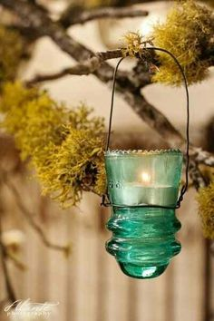 Old Telephone Pole Insulators make great votive holders. Need to do this with mine