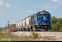 Florida East Coast Railroad (FEC) GP38-2 , A local works south from the siding at Oak Hill, FL.