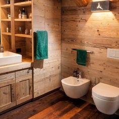 Bathroom Design: reclaimed old fir covering and furniture, reclaimed old larch flooring. Bagno: rivestimento e arredamenti in abete antico di recupero, pavimento in larice antico di recupero. #bathroomdesign #reclaimedwood #wood #fir #oldwood #mountainchalet #alps #luxurydesign #interiordesign #homedecor #design #woodlovers #legnoantico #legnodirecupero #abete #bagno #madeinitaly