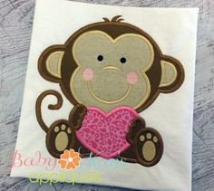 Baby Monkey Holding Heart - This sweet monkey is holding his heart close to him. This great design can be for boys or girls and is just right for Valentine's Day.