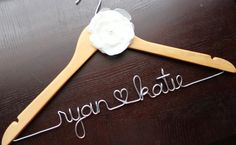 Wedding Dress Hanger - NATURAL - Personalized with Bride & Groom's names - Ivory Flower. $28.00, via Etsy.