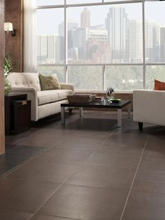 8 Flooring Trends to Try : Decorating : Home & Garden Television.  Pictured:  Large-Format Tile, looks classy, less grout lines to clean, and tons of colors and styles.