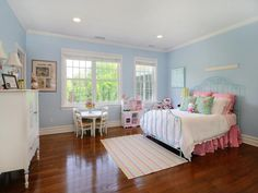 Perfect room for a little girl. love the turquoise iron bed and hints of pink