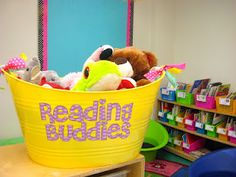 Kindergarten Smiles: reading buddies...hmmm, something to do with the bijillions of stuffed animals that have multiplied in my home?