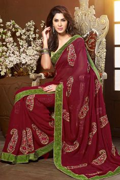 Pink Chiffon Saree with Art Silk Blouse ink chiffon saree with green art silk blouse. Embellished with embroidered, resham and zari. Saree comes with u neck blouse. It is perfect for casual wear, festival wear, party wear and wedding wear.