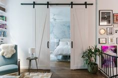 Sliding barn doors to the bedroom in a New York apartment