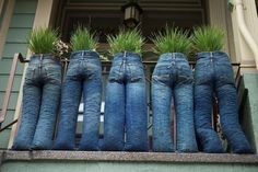 Denim bluejean jean Pants as front porch planters, fill with cement, stones or sand, add plants or flowers from your garden. For ideas and goods shop at Estate ReSale & ReDesign, Bonita Springs, FL