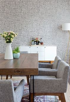 Our Modern Buffet + Mid-century Tripod Floor Lamp making a statement in this shared LA apartment on Dwell.com!